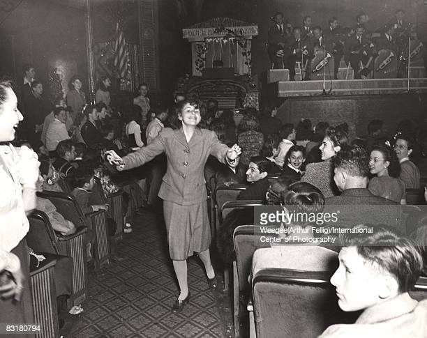 A young woman dances in the aisle during a Harry James concert at the Paramount Theater New York 1943 ''Current teenage craze for jivebombing...