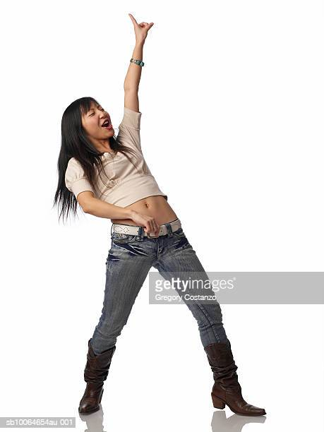 Young woman dancing ageist white background
