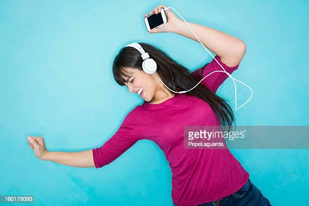Young woman dancing and enjoying