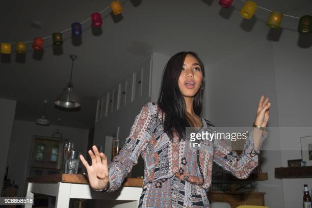 young woman dancing at a party - foco diferencial imagens e fotografias de stock
