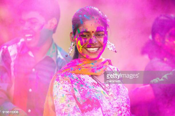 Young woman dancing at Holi festival in India