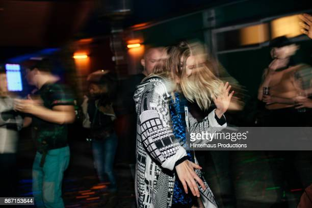 Young Woman Dancing Energetically At Nightclub