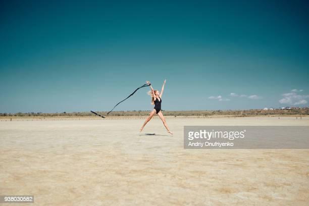 Young woman dancing in desert