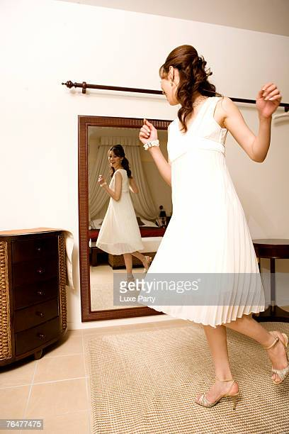 Young woman dancing in front of mirror