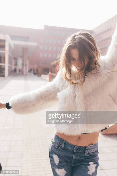 Young woman dancing in street