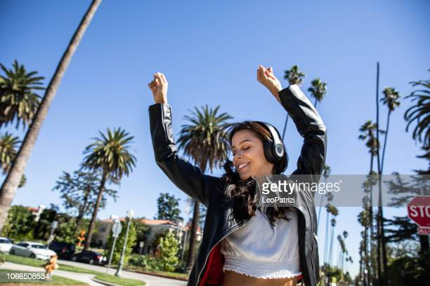 Young woman dancing in the street