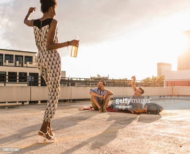 young woman dancing on a rooftop party - watch what happens: live stock pictures, royalty-free photos & images