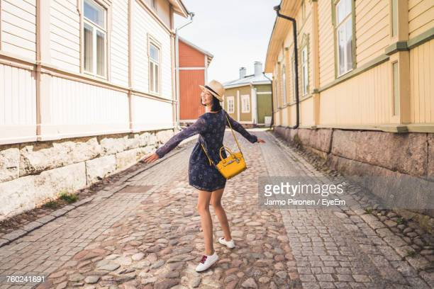 Young Woman Dancing On Footpath