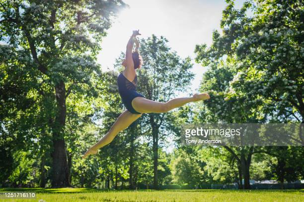 young woman dancing outdoors - bisexuality fotografías e imágenes de stock