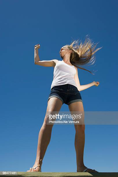 young woman dancing outdoors - blue shorts stock pictures, royalty-free photos & images