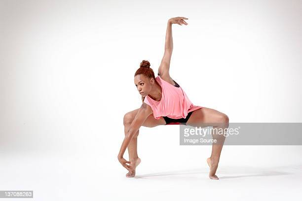 young woman dancing - legs spread woman stock photos and pictures