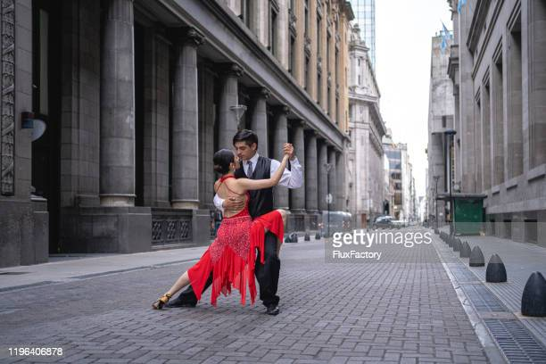 young woman dancing tango with her boyfriend - buenos aires stock pictures, royalty-free photos & images
