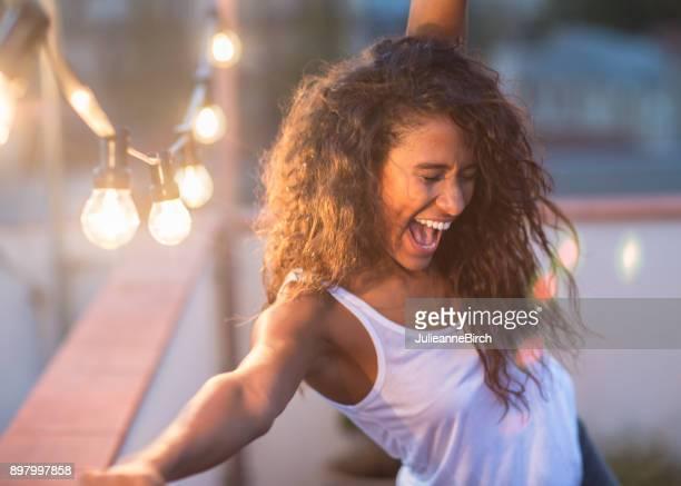 Young woman dancing the night away