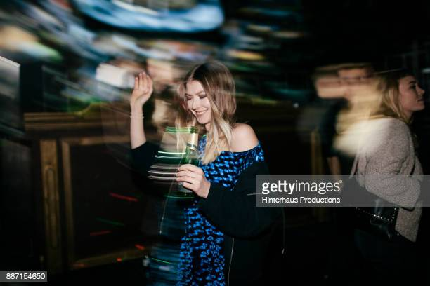 young woman dancing while drinking at nightclub - dance floor stock pictures, royalty-free photos & images
