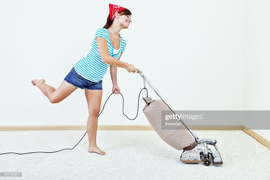 Young Woman Dancing with Vacuum Cleaner : Stock Photo