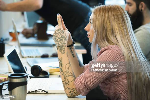 Young woman daydreaming in office