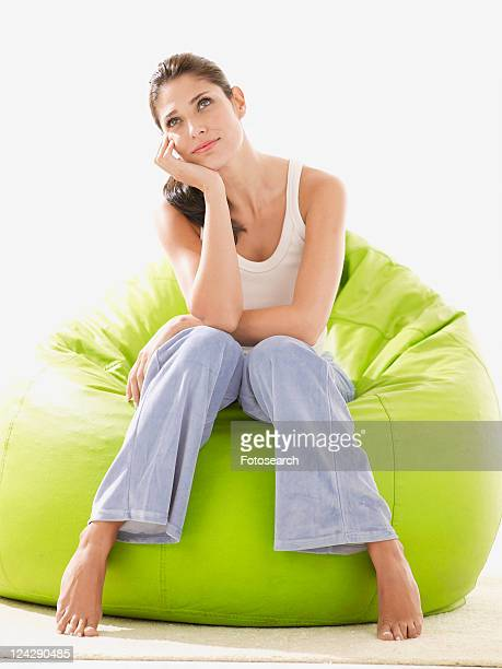 Young woman daydreaming on beanbag