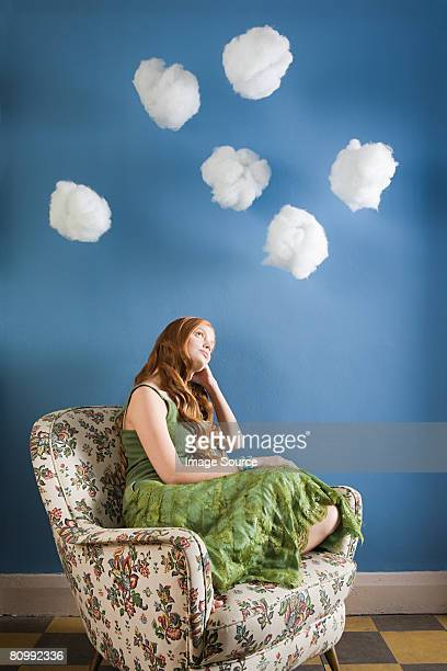 A young woman daydreaming