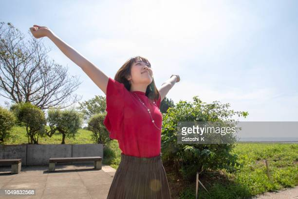 Young woman deep breathing under the sun
