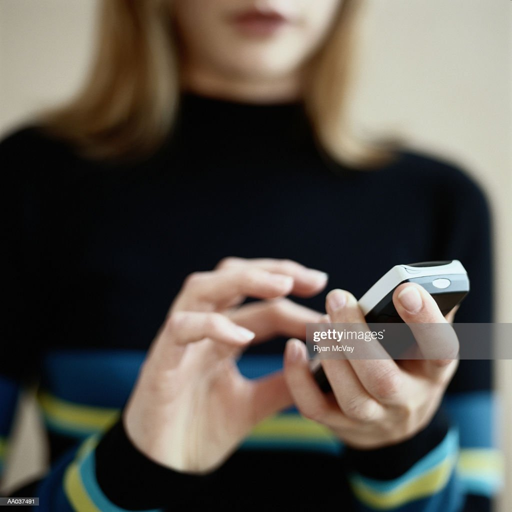 Young Woman Dialing Mobile Phone : Stock Photo
