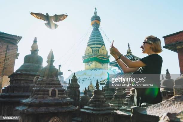 Young woman discovers Buddhist temple, Swoyambhu Stupa
