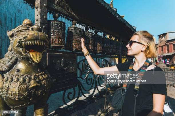 Young woman discovers Buddhist temple, Swoyambhu Stupa