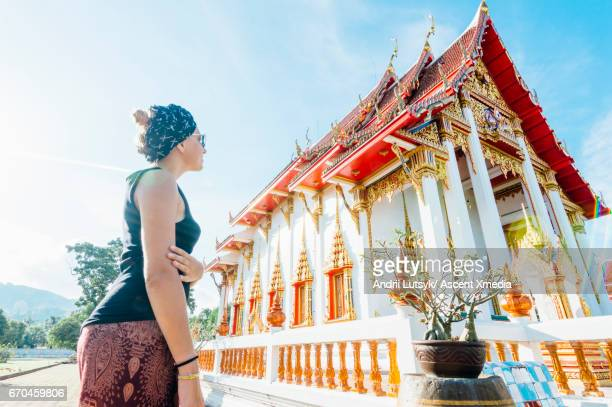 Young woman discovers Thai temple