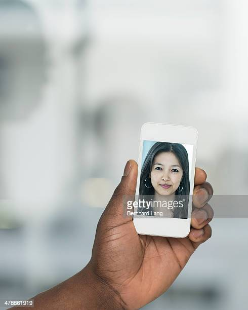 Young woman displayed on phone