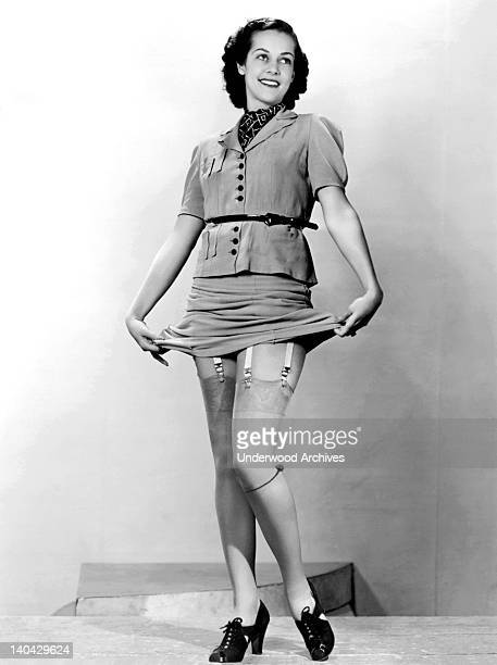 A young woman displays her garters and her nylon stockings United States circa 1940 By 1940 nylons were available to consumers nationwide but the...