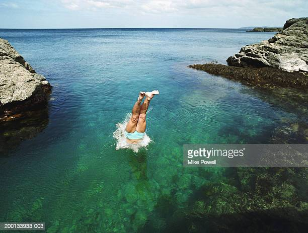 Young woman diving into water