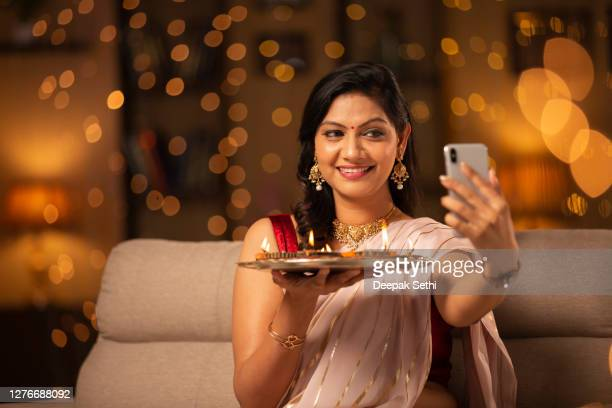 young woman diwali celebrate - stock photo - diwali decoration stock pictures, royalty-free photos & images