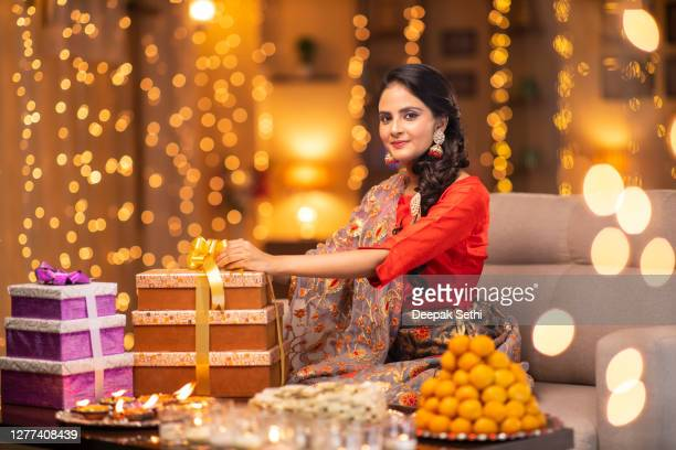 young woman diwali celebrate - stock photo - sweet food stock pictures, royalty-free photos & images