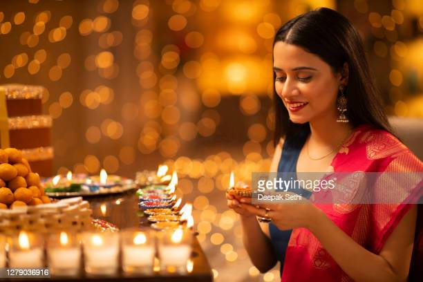 young woman diwali celebrate - stock photo - diwali stock pictures, royalty-free photos & images