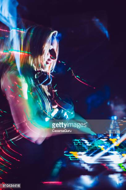 Young Woman DJ In Action on Turntables