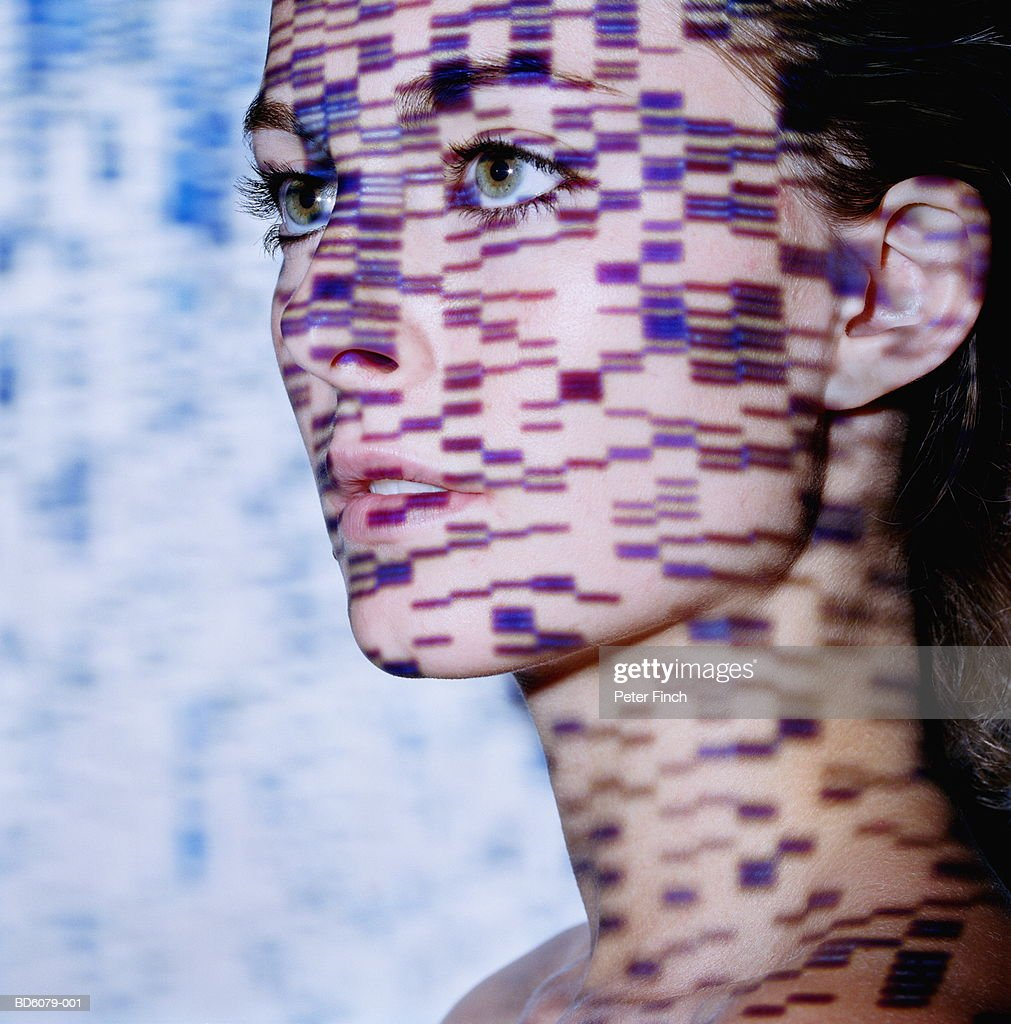 Young woman, DNA gels projected onto face : Stock Photo