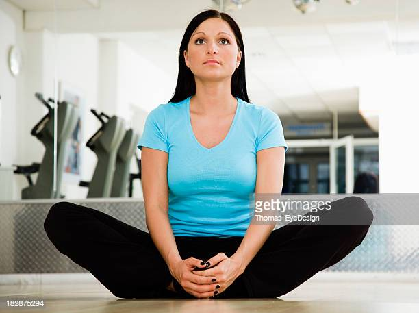 Young Woman Doing a Groin Stretching Exercise