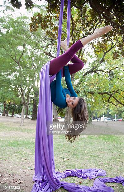 Young woman doing acrobatics in the tree