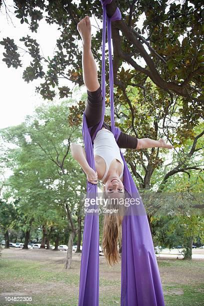 young woman doing acrobatics in the tree - 空中曲芸師 ストックフォトと画像