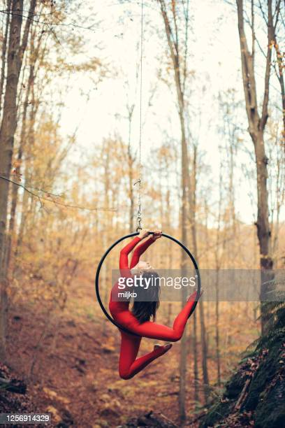 young woman doing aerial hoop dance outdoors - floor gymnastics stock pictures, royalty-free photos & images