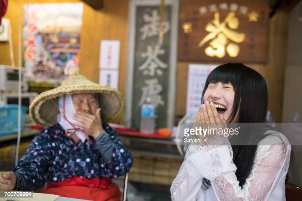 Young woman doing big laugh with senior woman