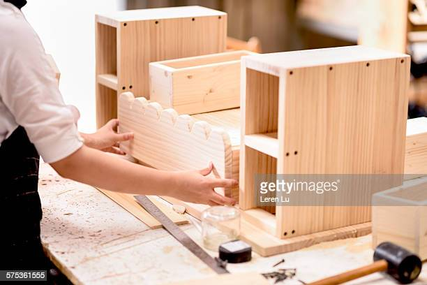 young woman doing carpentry - leren stock pictures, royalty-free photos & images