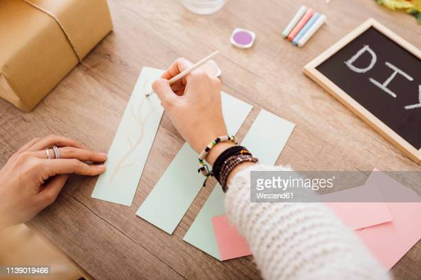 young woman doing crafts with watercolour in her studio - home made stock pictures, royalty-free photos & images