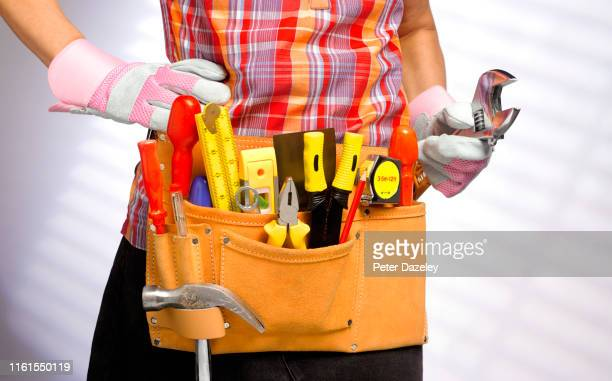 young woman doing diy - genderblend stock-fotos und bilder