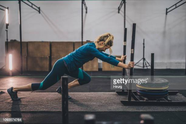 young woman doing exercise - circuit training stock photos and pictures