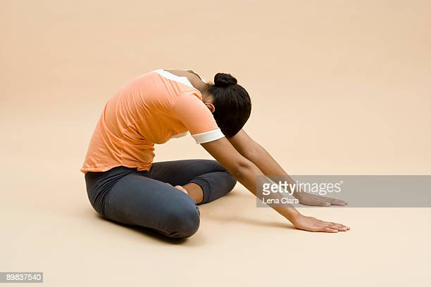 a young woman doing exercise - beige background stock pictures, royalty-free photos & images