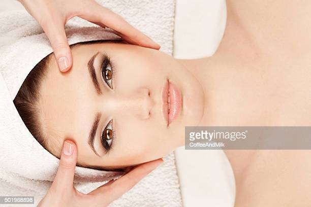 Young woman doing facial massage