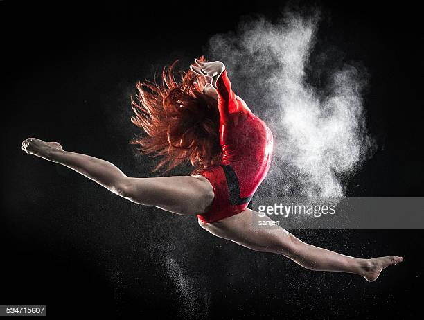 Young woman doing gymnastics jump