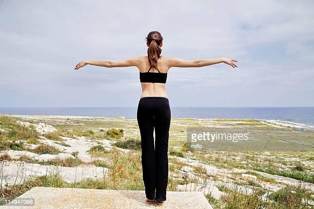 Young woman doing gymnastics