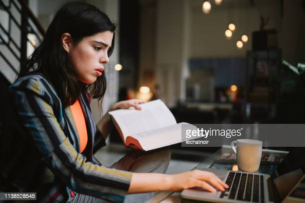 young woman doing her studies in Downtown Los Angeles apartment