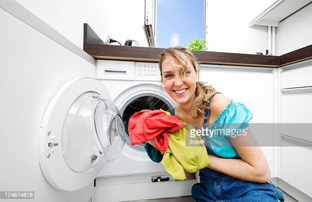 young woman doing laundry - izusek stock pictures, royalty-free photos & images